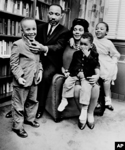 FILE - In this March 17, 1963, file photo, Dr. Martin Luther King Jr. and his wife, Coretta Scott King, sit with three of their four children in their Atlanta, Ga., home. From left are: Martin Luther King III, 5, Dexter Scott, 2, and Yolanda Denise, 7.