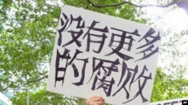"This ""Occupy"" protestor may have thought his sign said ""No More Corruption.""  Actually, as translated, it's closer to ""There isn't any more corruption."""