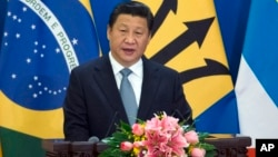 Presiden China Xi Jinping memberikan pidato pada pembukaan forum kerjasama dengan Amerika Latin dan Karibia di Beijing, Kamis (8/1).