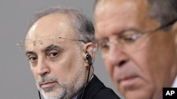 Iranian Foreign Minister Ali Akbar Salehi, left, looks on Russian Foreign Minister Sergei Lavrov during a news conference after their meeting in Moscow, Russia, August 17, 2011