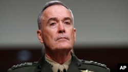 "FILE - Joint Chiefs Chairman Gen. Joseph Dunford on Capitol Hill in Washington, June 13, 2017. Military chiefs will seek a six-month delay before letting transgender people enlist in their services, officials said June 23. Dunford told a Senate committee there have been some issues identified with recruiting transgender individuals that ""some of the service chiefs believe need to be resolved before we move forward."""