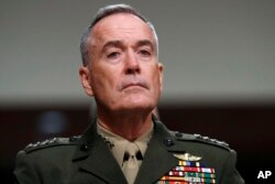 FILE - Joint Chiefs Chairman Gen. Joseph Dunford on Capitol Hill in Washington, June 13, 2017. Military chiefs will seek a six-month delay before letting transgender people enlist in their services, officials said June 23.