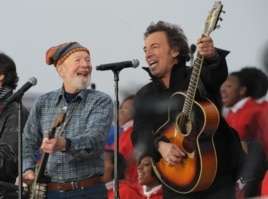 "FILE - U.S. singers Pete Seeger (L) and Bruce Springsteen (R) performing during the ""We are One"" Inaugural Celebration at the Lincoln Memorial on Jan. 18, 2009, in Washington, D.C."