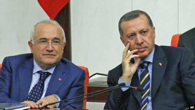Turkey's Prime Minister Recep Tayyip Erdogan (R) and then-deputy Cemil Cicek listen as Interior Minister Besir Atalay [not pictured] addresses members of parliament during a debate at the Turkish Parliament in Ankara, Turkey, November 2009. (file photo)