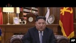 Shugaba Kim Jong Un a wani hoton bidiyo da ba ambaci ranar da aka dauka ba, yana jawabi