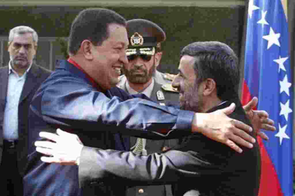 Iranian President Mahmoud Ahmadinejad, right, welcomes his Venezuelan counterpart Hugo Chavez, during official ceremony, in Tehran, Iran, 19 Oct. 2010.