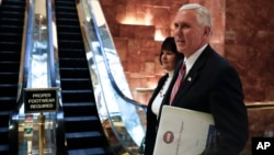 Vice President-elect Mike Pence and his wife Karen arrives at Trump Tower, Nov. 15, 2016, in New York.