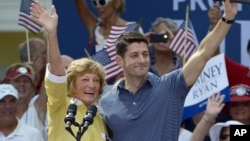 Republican vice-presidential candidate Paul Ryan and his mother Betty Ryan Douglas wave to supporters at a campaign rally in The Villages, Fla., Aug. 18, 2012.