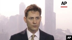 In this image made from a video taken on March 28, 2018, former Canadian diplomat Michael Kovrig speaks during an interview in Hong Kong.