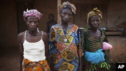 Women who survived the civil war pose for a portrait in the village of Bomaru, where the conflict started in 1991, in eastern Sierra Leone, April 22, 2012.