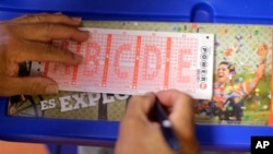 A Powerball lottery form is filled out in San Antonio, Texas, Aug. 7, 2013.