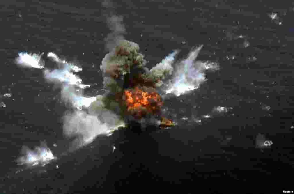 An explosion is seen after a new Iranian locally made cruise missile was fired during war games in the northern Indian Ocean and near the entrance to the Gulf, Iran, June 17, 2020.