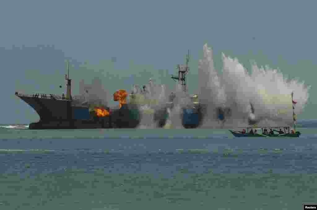 Indonesian Navy and the Ministry of Maritime Affairs and Fisheries blow up the illegal fishing vessel the MV Viking in the waters of Tanjung Batumandi, Pangandaran, West Java in this photo taken by Antara Foto.
