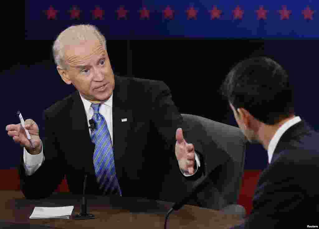 U.S. Vice President Joe Biden (L) debates Republican vice presidential nominee Paul Ryan (R) during the vice presidential debate October 11, 2012.