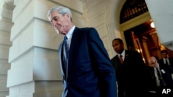 FILE - Former FBI Director Robert Mueller, the special counsel probing Russian interference in the 2016 election, departs Capitol Hill following a closed door meeting in Washington, June 21, 2017.