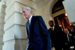 FILE - Former FBI Director Robert Mueller, the special counsel probing Russian interference in the 2016 election, departs Capitol Hill following a closed-door meeting in Washington, June 21, 2017.