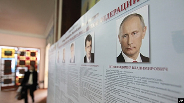 A board with the profiles of various presidential candidates, amongst them Russia's current Prime Minister Vladimir Putin, is on display during the preparations for the upcoming presidential elections at a polling station in the southern Russian city of S