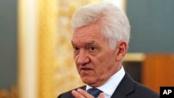 FILE - Russian tycoon Gennady Timchenko is seen prior to a meeting of Russian President Vladimir Putin and Chinese President Xi Jinping with businessmen in the Kremlin in Moscow, Russia, July 4, 2017.