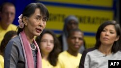 Burma's opposition leader Aung San Suu Kyi speaks during a town hall meeting hosted by Amnesty International in Washington on September 20, 2012.