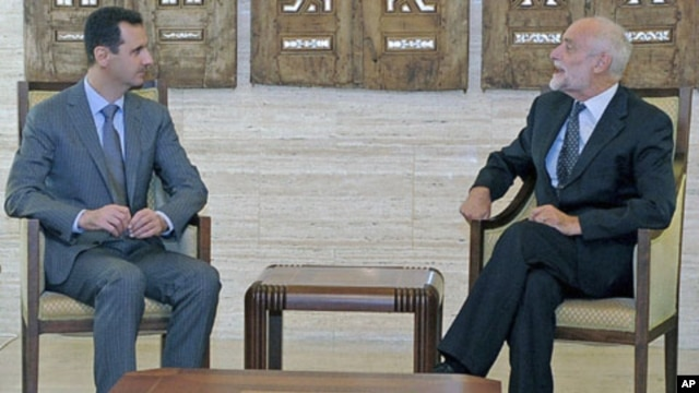 Syria's President Bashar al-Assad (L) meets Jakob Kellenberger, president of the International Committee of the Red Cross [ICRC], in Damascus, Syria, September 5, 2011.