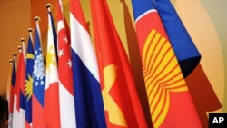 FILE PHOTO - The Association of the Southeast Asian Nations (ASEAN) flag, right, leads the flags of the 10-member countries during the ASEAN Regional Forum meeting in Singapore Wednesday, July 23, 2008.