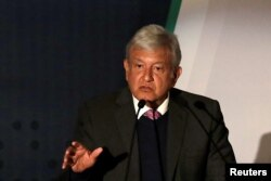 FILE - Mexican President-elect Andres Manuel Lopez Obrador talks about his security plan to the media in Mexico City, Nov. 14, 2018.