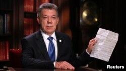 FILE - Colombia's President Juan Manuel Santos speaks during a presidential address in Bogota, Oct. 10, 2016.