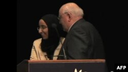 High school student Manal Saleh introduces Mikhail Gorbachev at the 12th World Summit of Nobel Peace Laureates, in Chicago