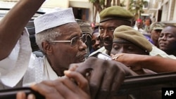 FILE - Former Chadian leader Hissene Habre, left, in Dakar, Senegal, in 2005.