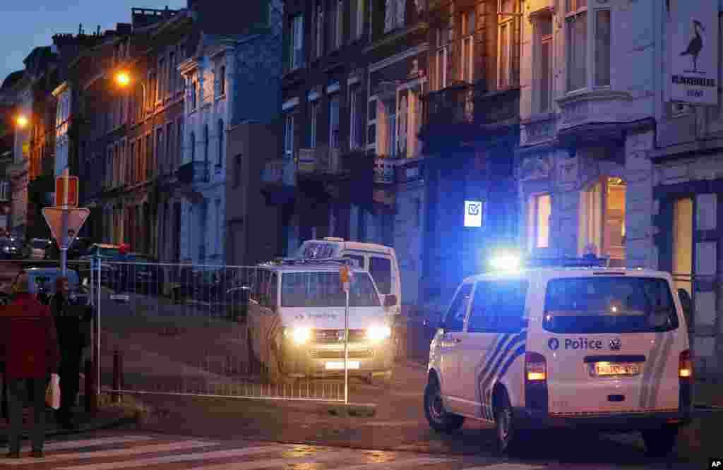 Belgian police officers guard a street in Verviers, Belgium, Jan. 16, 2015.