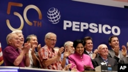 FILE - PepsiCo Chairwoman and CEO Indra K. Nooyi, center, is applauded as she rings the New York Stock Exchange opening bell to celebrate the 50th anniversary of the merger of Frito-Lay and Pepsi-Cola, June 8, 2015.