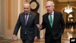 Senate Majority Leader Mitch McConnell, R-Kentucky, right, and Senate Minority Leader Chuck Schumer, D-New York, walk to the chamber after collaborating on a budget deal at the Capitol, in Washington, Feb. 7, 2018.