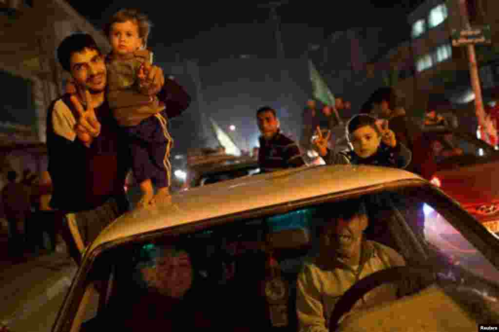 Palestinians celebrate the cease-fire between Israel and Hamas, Gaza City, Nov. 21, 2012.