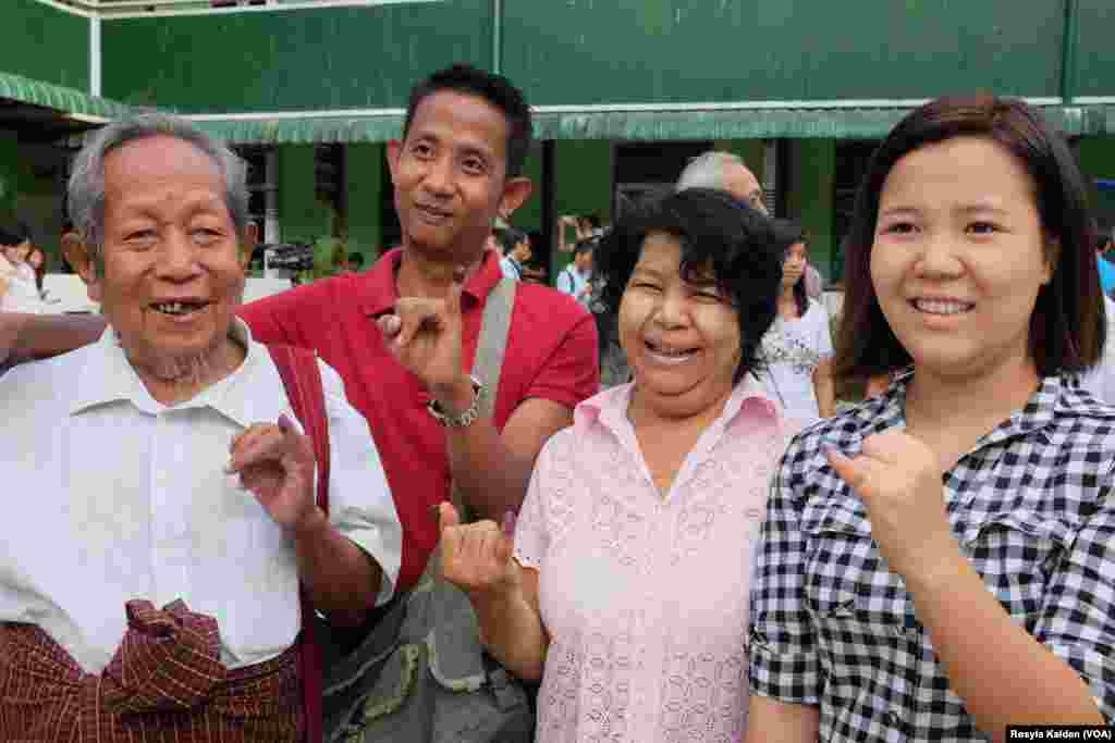 Sein Kyi, 87, and his family members display their inked fingers after voting in Yangon, Nov. 8, 2015.