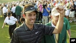 Charl Schwartzel of South Africa celebrates after finishing the final round of the Masters golf tournament Sunday, April 10, 2011, in Augusta, Georgia