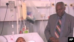 Peter Kamau with a patient