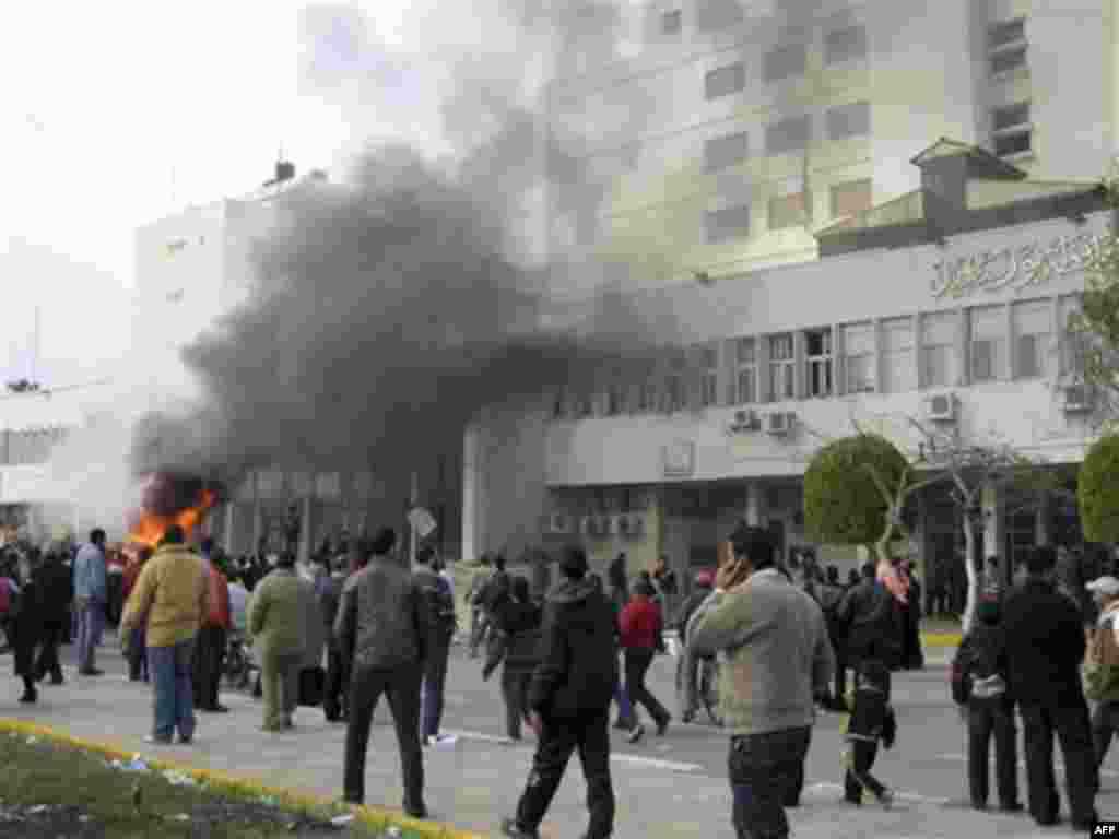 The local government headquarters, is set on fire by protesters, claiming delays on requests for housing in Port Said Thursday, Feb. 10, 2011. Labor unrest across the country gave powerful momentum to Egypt's wave of anti-government protests. With its e