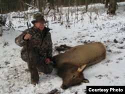 Gerald Stoudemire poses with an elk harvested in Pennsylvania a couple of years ago. He's president of Gun Owners of South Carolina, a gun rights group.
