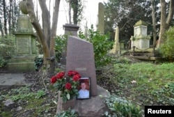 FILE - The grave of murdered ex-KGB agent Alexander (Sasha) Litvinenko is seen at Highgate Cemetery in London, Britain, Jan. 21, 2016. He was poisoned in 2006 with tea containing radioactive polonium-210.