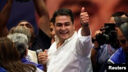 Juan Hernandez, presidential candidate for the ruling National Party, gestures to supporters in Tegucigalpa Nov. 24, 2013.