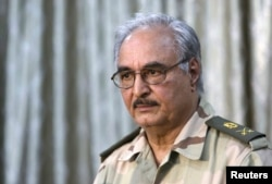 FILE - General Khalifa Haftar attends a news conference in Abyar, east of Benghazi, May 17, 2014.