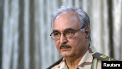 General Khalifa Haftar attends a news conference in Abyar, east of Benghazi, May 17, 2014.