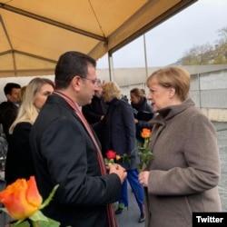 德国总理默克尔11月9日出席柏林墙倒塌30周年纪念活动。