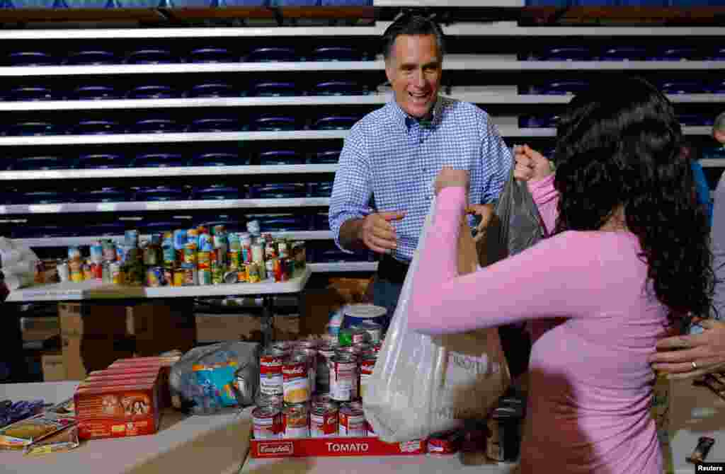 Mitt Romney accepts relief supplies for people affected by Hurricane Sandy at a storm relief campaign event in Kettering, Ohio October 30, 2012.