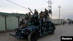 Les forces de sécurité kurdes en patrouille à Kirkouk, Irak, le 22 octobre 2016.