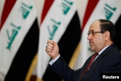 FILE - Iraq's Prime Minister Nuri al-Maliki speaks during an interview with Reuters in Baghdad in 2014..