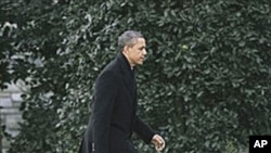 President Barack Obama walks back to the Oval Office of the White House in Washington, February 10, 2011