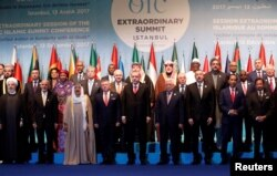 Leaders and representatives of the Organisation of Islamic Cooperation (OIC) member states pose for a group photo during an extraordinary meeting in Istanbul, Turkey, Dec. 13, 2017.