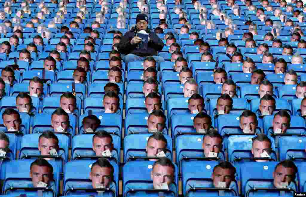 Jamie Vardy masks are seen on the seats before the English Premier League football match between Leicester City and Everson at King Power stadium in Leicester, central England.