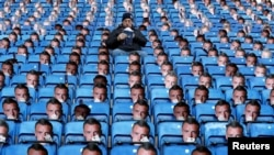 Britain Soccer Football - Leicester City v Everton - Premier League - King Power Stadium - 26/12/16 General view of a fan with Jamie Vardy masks on the seats before the match.